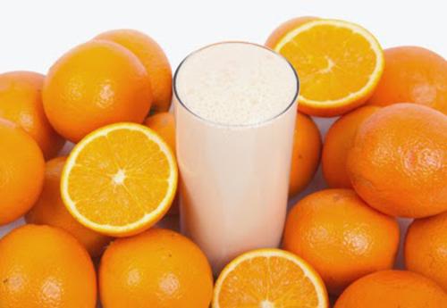 Cam và sữa tươi làm trắng da và trị mụn hiệu quả